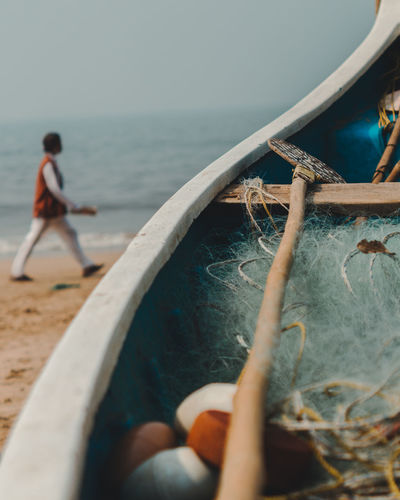 Close-up of oar and fishing net in boat