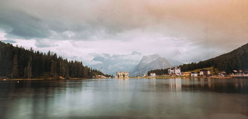 Scenic View Of Lake Misurina Against Cloudy Sky During Sunset
