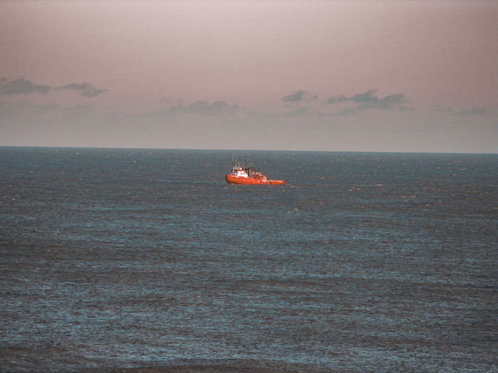orange red boat in Norfolk Fishing Boat Golden Hour Coral Colored Norfolk Uk Northsea Last Light Of Day Fishing Industry Sea Nautical Vessel Sky Horizon Over Water Ship Water Vehicle Industrial Ship Boat Mast Aerial View