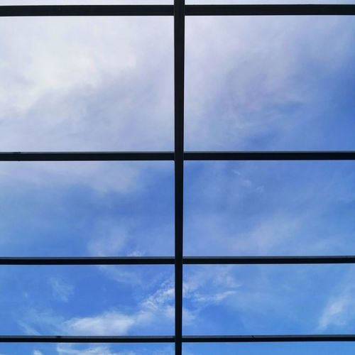 Low angle view of sky seen through glass window