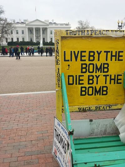 Live by the bomb die by the bomb White House Text Politics Communication Architecture Outdoors Message Endwar Peace Love