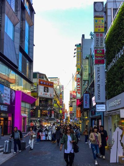 Shops at Myeongdong in Seoul, South Korea Travel Torism People Busy Retailers Retail  Shopping Shops ASIA Seoul South Korea MyeongDong City Architecture Building Exterior Built Structure Street Group Of People Crowd City Life Building Real People Road Sign City Street Large Group Of People