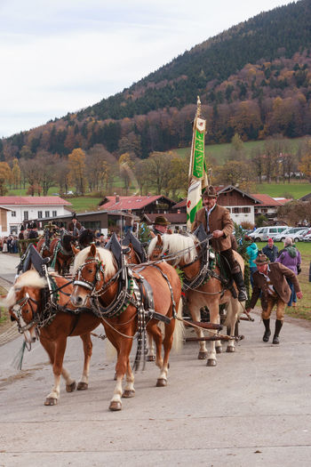 Hundham, Bavaria - November 4, 2017: Every year on the 1st Saturday in November the Idyllic Horse procession, named Leonhardi in the Bavarian Hundham takes place in memory of Patron St. Leonhard. In traditional clothing and decorated horse-drawn carriages horses and riders move to the church of St. Leonhard Bavaria Church Hundham Leonhardi Leonhardi Ride Leonhardiritt Patron St.Leonhard ST.Leonhard Traditional Clothing Bodice Carriage Customs Day Decorated Dirndl Horse Horse Procession Horse-drawn Vehicle Idyllic Leather Trousers Men Outdoors Riders Rogue Women