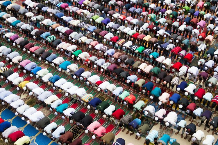 High Angle View Of Men Praying In Mosque