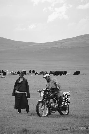Mongolia Adult Black And White Day Deel Environment Full Length Land Land Vehicle Landscape Men Mode Of Transportation Nature Nomadic Nomadic Life Outdoors Real People Riding Sky Steppe Transportation Монгол улс дээл