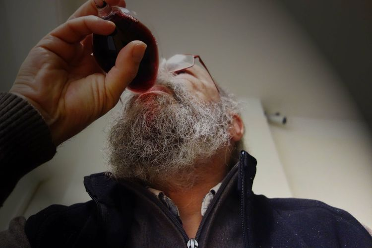 Close-Up Of Mature Man Drinking Red Wine