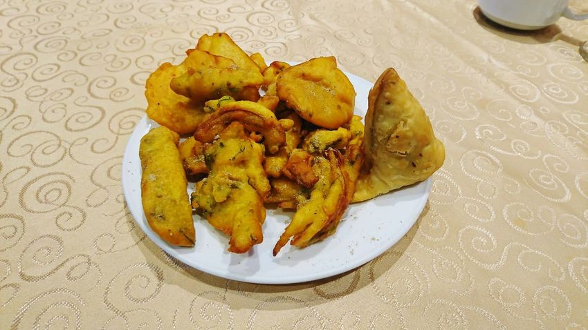 Samosa and pakoda Samosa Pakoda Snacks Tea Time Indian Snacks Table Plate Food And Drink No People Food Indoors  Ready-to-eat
