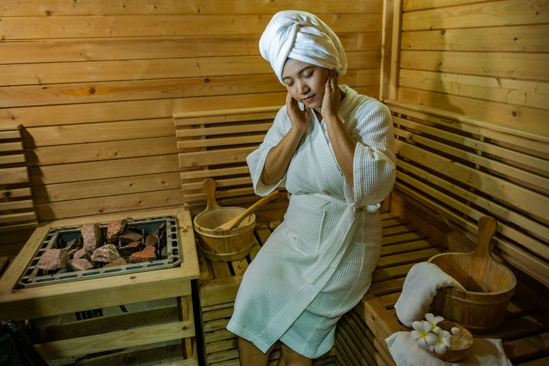 Woman sitting at sauna room