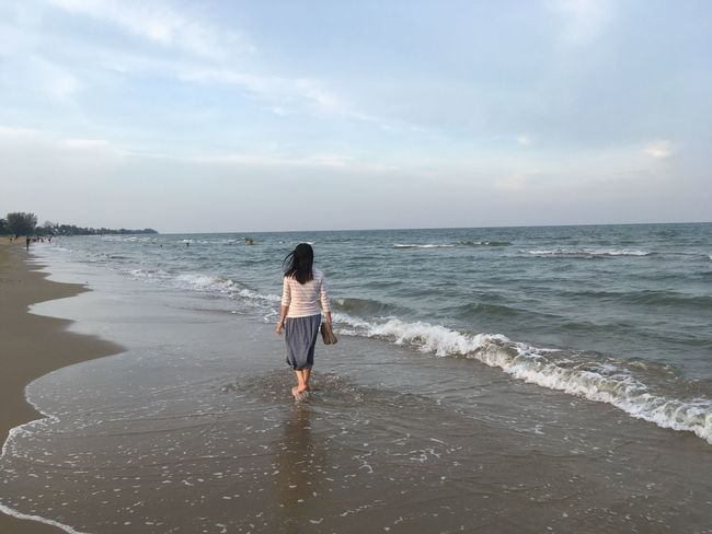Alone Alone The Beach  Sea Water Beach Sky Land Beauty In Nature Horizon Scenics - Nature One Person Leisure Activity Rear View Outdoors Idyllic Nature Holiday Lifestyles Non-urban Scene Real People Horizon Over Water