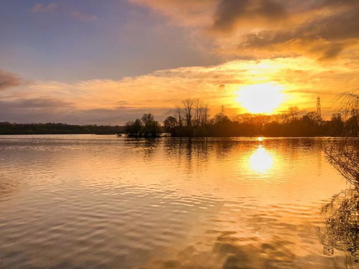 Autumn Sunset Sky Sunset Water Beauty In Nature Scenics - Nature Tranquility Tranquil Scene Reflection Cloud - Sky Lake Waterfront Idyllic Nature No People Orange Color Tree Non-urban Scene Sun Plant Outdoors