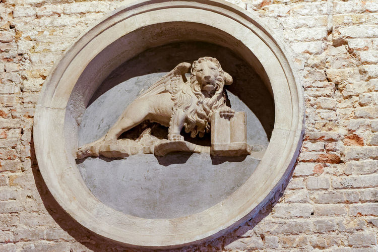 Venetian lion Art And Craft Architecture Representation Sculpture Craft Creativity No People Statue Stone Material Built Structure Day History Solid Human Representation Carving - Craft Product The Past Interior Lion