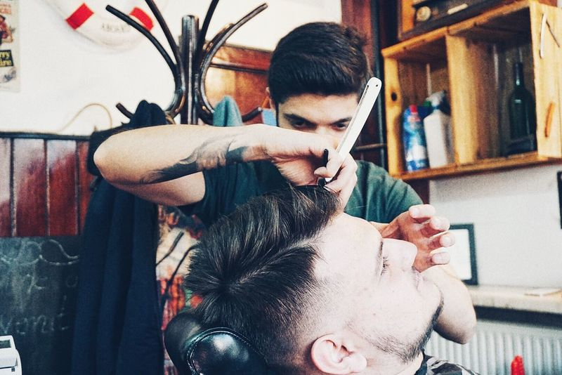 Barbershop Real People Lifestyles Indoors  Working Two People Young Adult Body Care Men Occupation Hairdresser Cutting Hair Hair Care Hair Salon Only Men Day