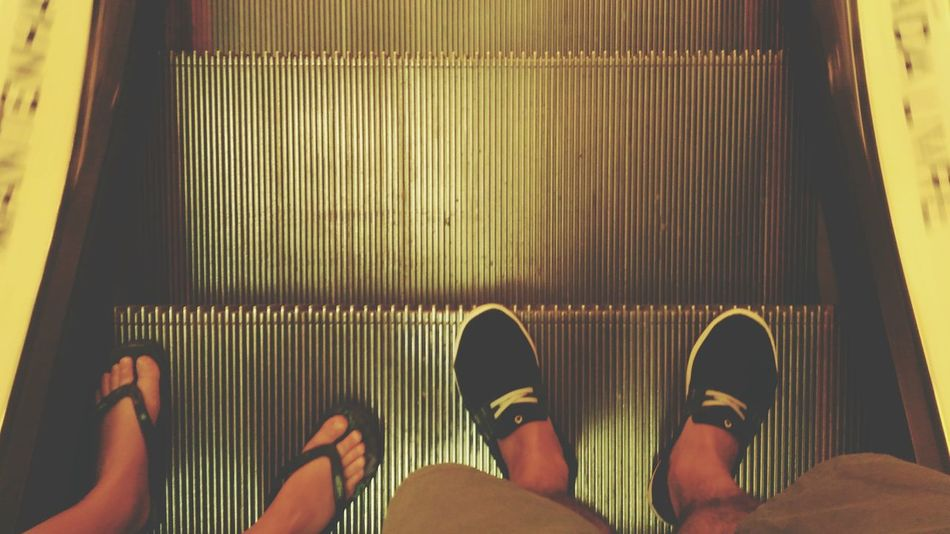 Shoe Personal Perspective Human Leg Low Section Indoors  Human Body Part People Escalator In Service. Escalators And Steps Escalators And Staircases Metal Built Structure Steps And Staircases Staircase Indoors  Close-up