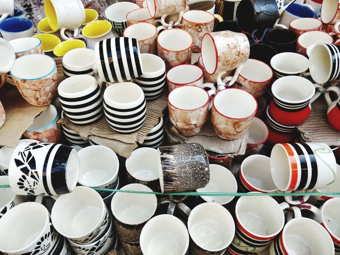 Full frame shot of coffee cups for sale in store