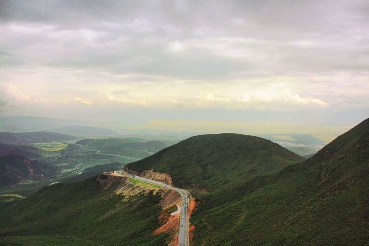 Sky Mountain Beauty In Nature Tranquility Cloud - Sky Tranquil Scene Nature Scenics Landscape No People Day Outdoors Mountain Range Winding Road color readjusted