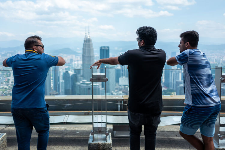 Kuala Lumpur Men Architecture Built Structure Building Exterior Rear View Standing City Togetherness Casual Clothing Real People Sky Lifestyles Young Men Day Nature Three Quarter Length Adult Friendship Leisure Activity Two People Outdoors Cityscape Petronas Twin Towers