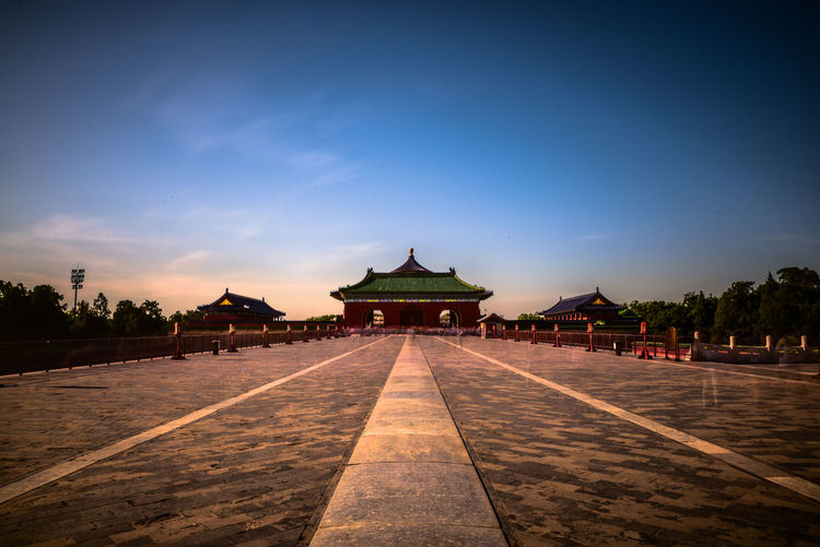 Sunset in Temple of Heaven. Architecture Blue Cities At Night Building Built Structure Cloud Day Diminishing Perspective Empty Footpath Nature Outdoors People Road Sky The Architect - 2016 EyeEm Awards The Great Outdoors - 2016 EyeEm Awards The Great Outdoors With Adobe The Way Forward Tourism Tranquility Travel Travel Destinations Traveling Walkway