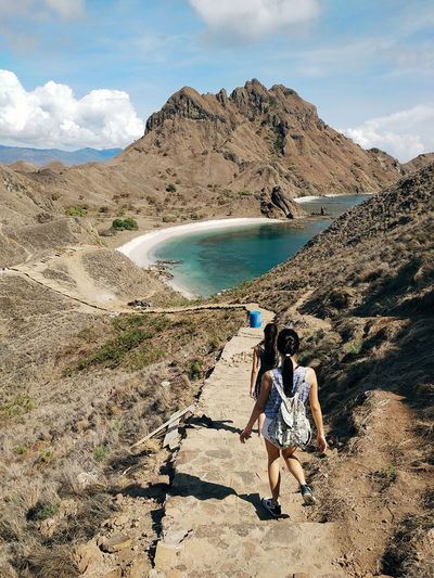 Pulau Padar, Flores Indonesia in dry season padar island flores INDONESIA mountain komodo National park Nusa Tenggara Stairs dry first eyeem photo Padar Island Flores INDONESIA Mountain Komodo National Park Nusa Tenggara Stairs Dry Nature Sky Beauty In Nature Adventure One Person Scenics Hiking Water Backpack Outdoors Casual Clothing People Sea Day Full Length Rear View Leisure Activity Real People Lifestyles Standing Young Adult EyeEmNewHere