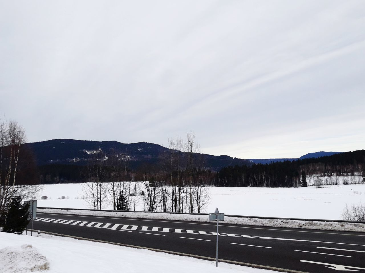 winter, snow, cold temperature, nature, scenics, beauty in nature, transportation, tranquil scene, sky, tranquility, outdoors, no people, mountain, road, day, landscape, tree