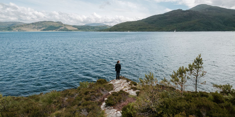Beauty In Nature Casual Clothing Day Fishing Fishing Pole Full Length Isle Of Skye Leisure Activity Lifestyles Men Mountain Mountain Range Nature One Person Outdoors Real People Rear View Scenics Scotland Sea Sky Standing Tranquil Scene Tranquility Water
