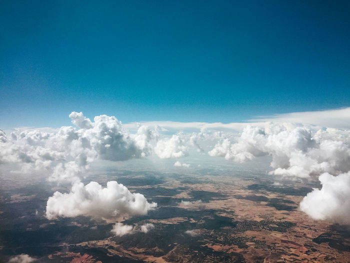 Above Aerial View Beauty In Nature Blue Cloud - Sky Cloudscape Copy Space Day Environment Fluffy Idyllic Landscape Meteorology Nature No People Non-urban Scene Outdoors Pollution Scenics - Nature Sky Smoke - Physical Structure Tranquil Scene Tranquility