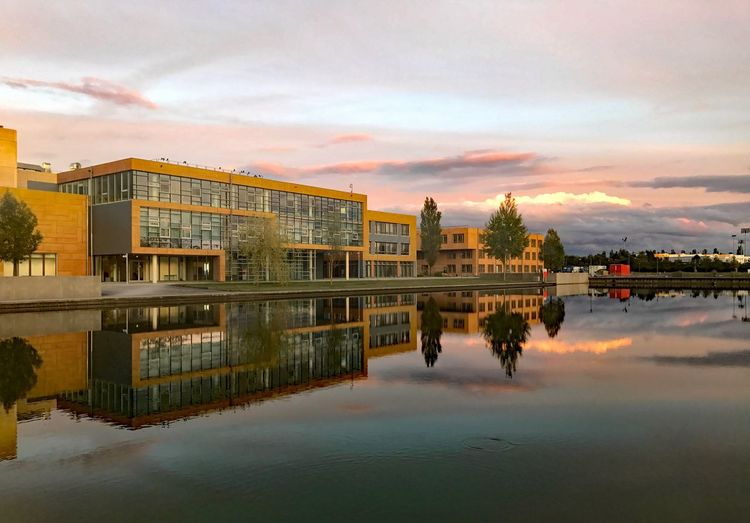 Architecture Built Structure Building Exterior Reflection Sky Cloud - Sky Water Sunset Waterfront No People Outdoors Travel Destinations City Nature Day Infineon headquarter Site ifx 623100