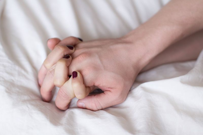Young couple holding hands in bed on white sheets Relaxing Moments Couple Relationshipgoals Relationship Married Honeymoon Bedroom Cozy Bedtime Sleep Time Morning Sleepping Sensitive Sensual 💕 Passion Love Emotion Care Sleep Time Bed Human Hand Lying Down Sleeping Relaxation Linen Sheet