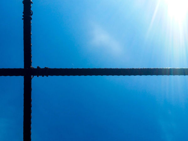 Blue Bright Close-up Low Angle View Nature No People Outdoors Pole Reinforcement Bar Rusty Scenics Sky Sun Sunbeam Sunlight Sunny