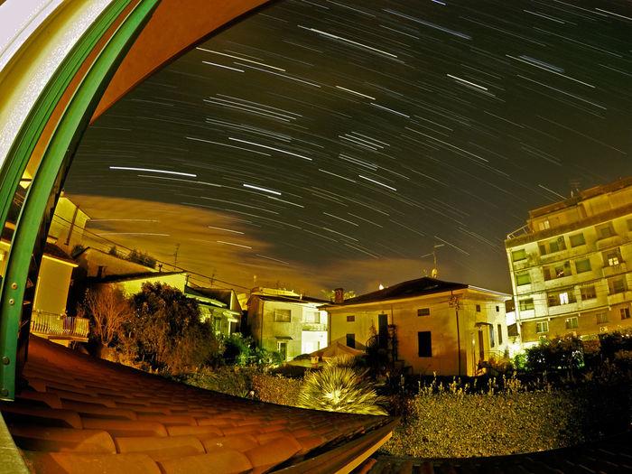 Illuminated trees against sky at night