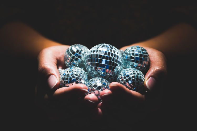 Hands holding disco balls Close-up Crystal Disco Discoball Human Body Part Human Hand Illuminated Night Club Nightclub Nightlife One Person Party People The Creative - 2018 EyeEm Awards