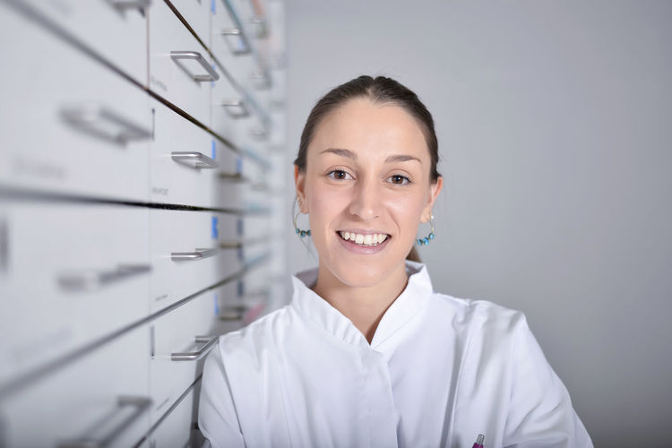 Portrait Of Smiling Young Woman Wearing Lab Coat