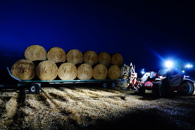 Panoramic view of agricultural field against sky at night