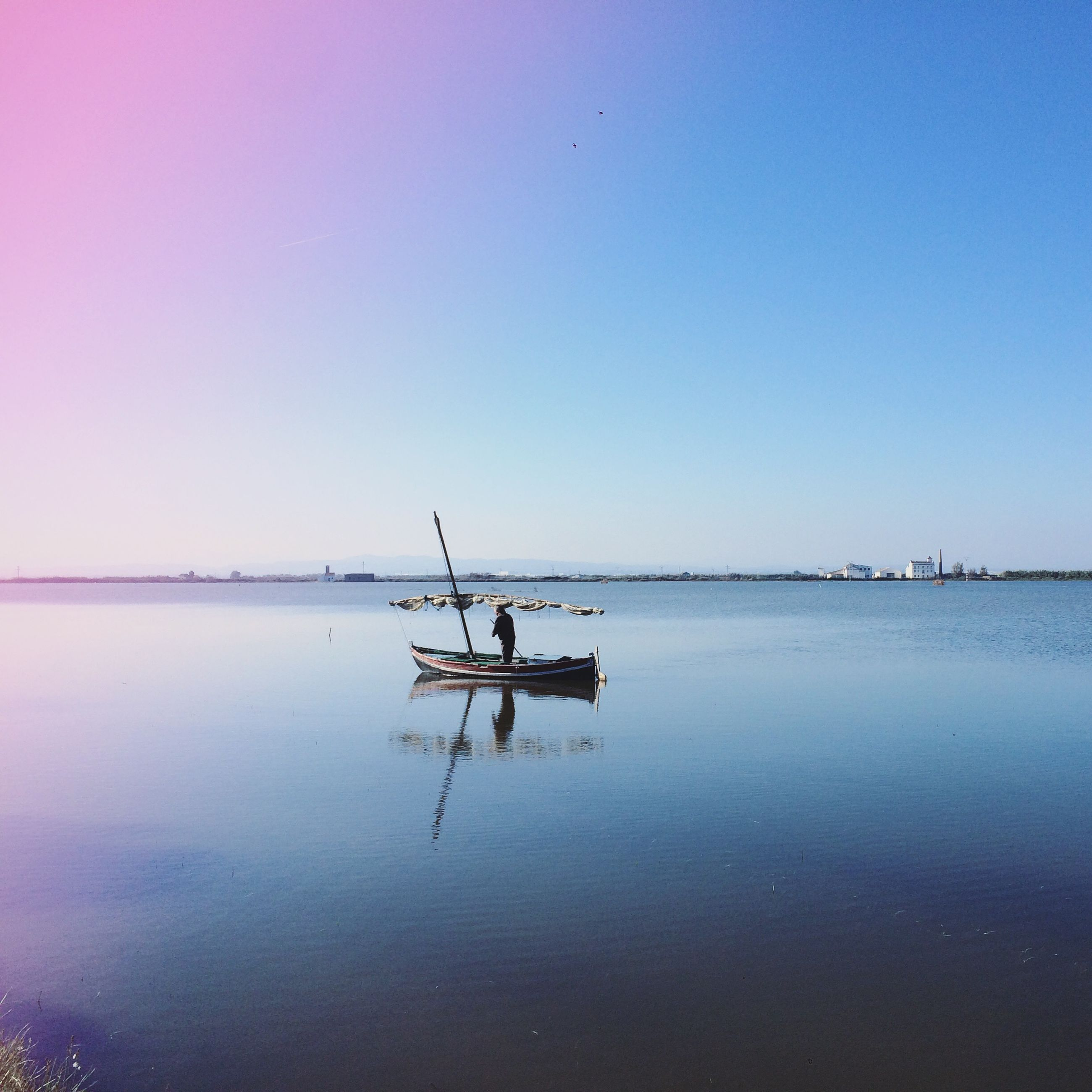 water, transportation, nautical vessel, mode of transport, waterfront, boat, clear sky, copy space, reflection, sea, tranquility, sailing, tranquil scene, travel, nature, silhouette, scenics, sky, outdoors, lake