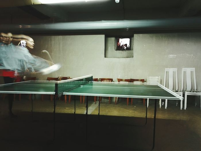 Blurred motion of woman playing table tennis