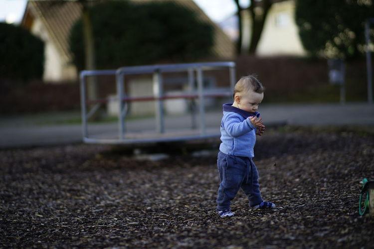 Cute boy walking in playground