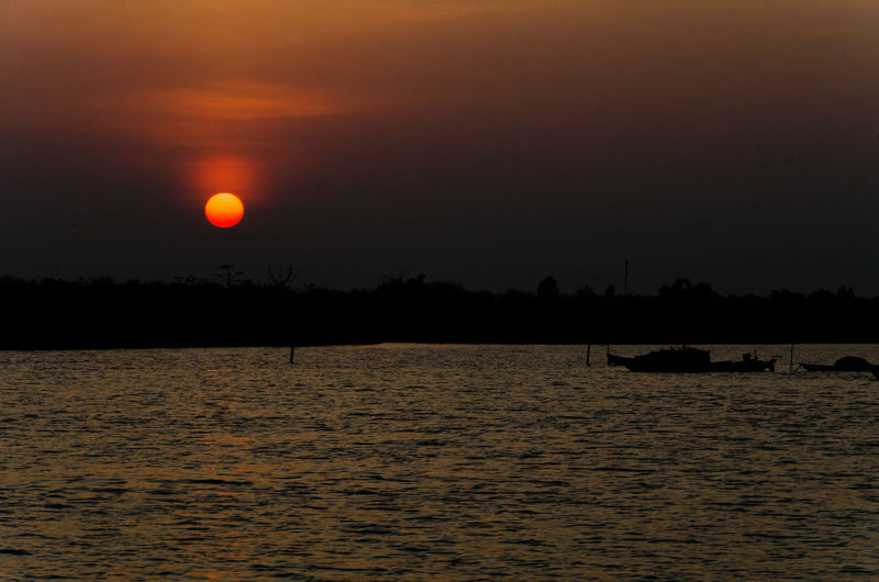 Beauty In Nature Cloud - Sky Eclipse Idyllic Nature No People Non-urban Scene Orange Color Outdoors Scenics - Nature Sea Silhouette Sky Sun Sunset Tranquil Scene Tranquility Water Waterfront