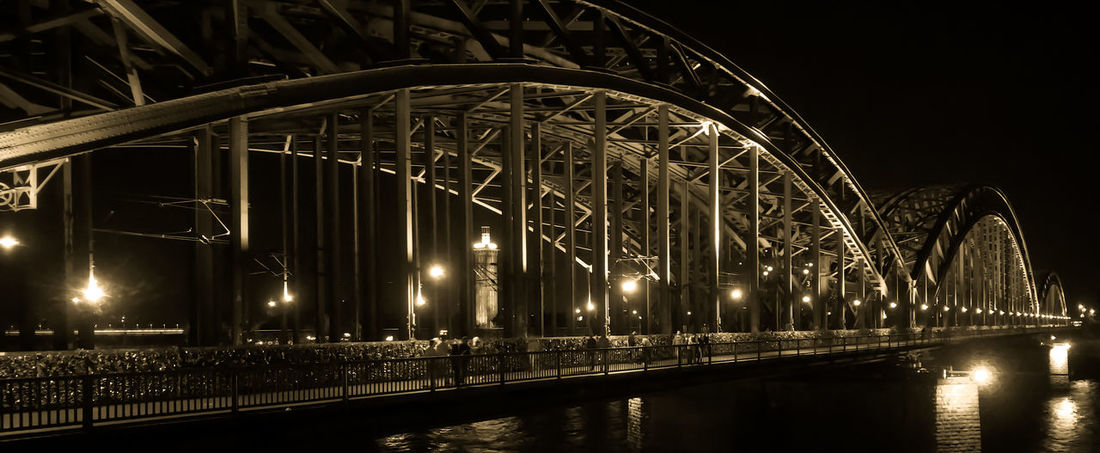 Midnight by Hohenzollern Bridge Cologne Hohenzöllern Bridge Nightphotography Architecture Bridge - Man Made Structure Built Structure Connection Illuminated Night No People Outdoors Scenery Sky Transportation