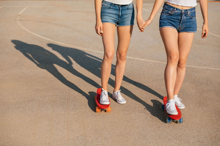 Low section of women wearing shoes