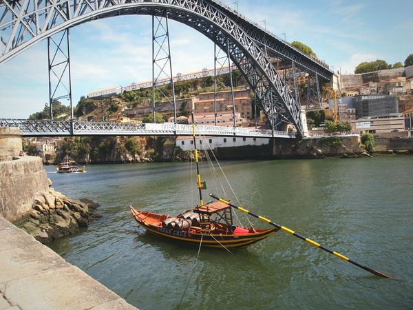 Douro river River Douro  Bridge Porto Portugal Boat Wood Iron Barrels Transport Vintage Outdoors Water Architecture Life No People Eyeemphotography EyeEm Gallery Colors Calm Placid  The Street Photographer - 2017 EyeEm Awards