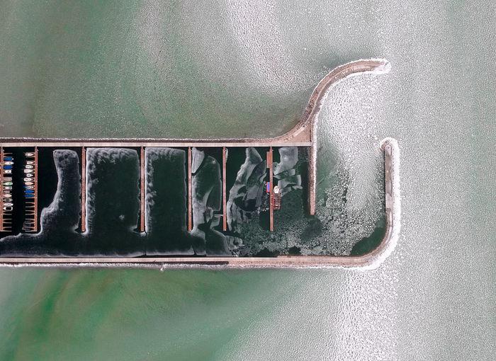 High angle view of metal window on wall