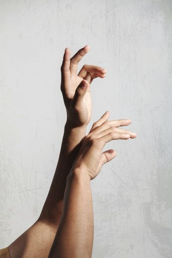 Midsection of man hand against wall