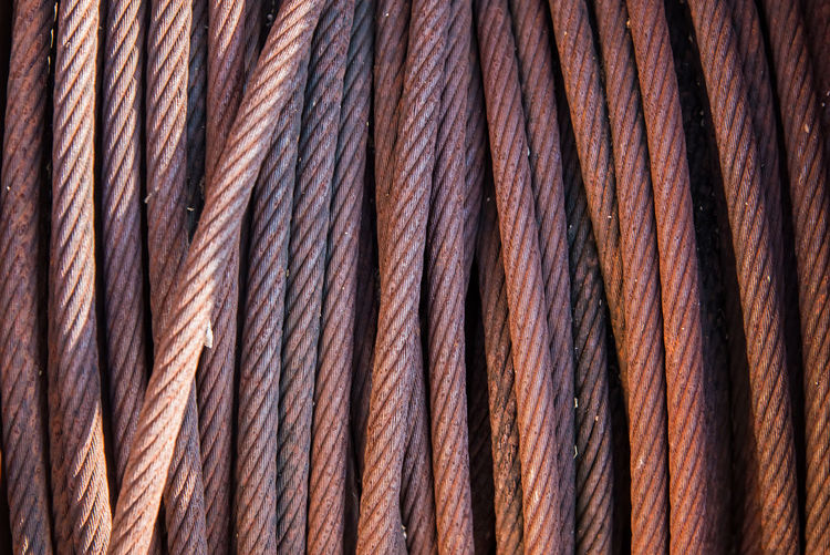 Background with a coiled steel cable Abundance Backgrounds Braided Braided Hair Brown Close-up Extreme Close-up Freight Transportation Full Frame Hair Hairstyle Industry Large Group Of Objects Macro No People Pattern Rope Striped Textile Textured