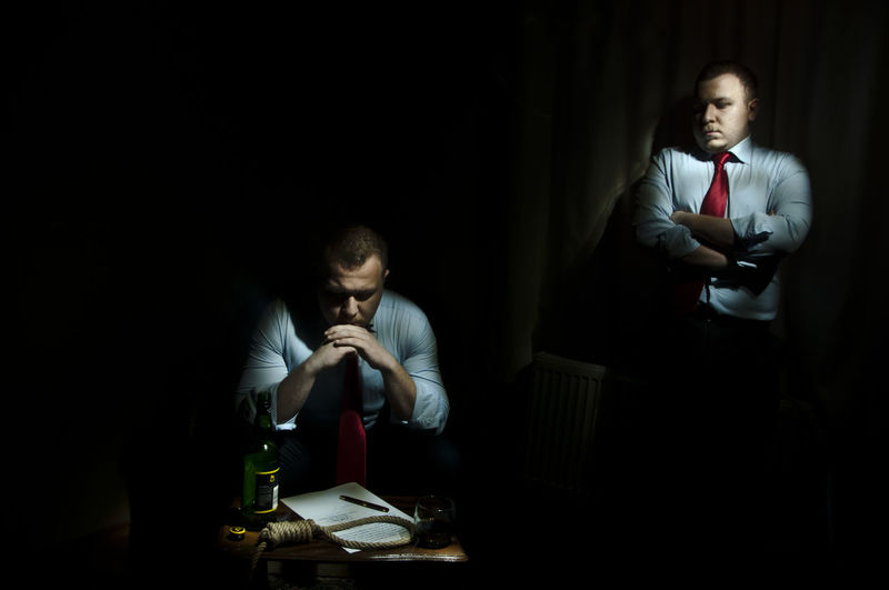 Multiple Exposure Of Guilty Businessman With Suicide Rope And Documents