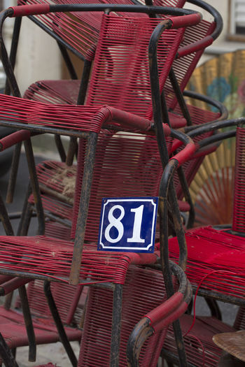 Scenery with old chairs and number 81 on a flea market in Lille, France 81 Retro Sign Brocante Chair Fleamarket No People Number Red Still Life Street Scene Vintage
