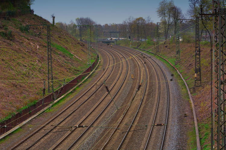 High angle view of railroad tracks on field against sky