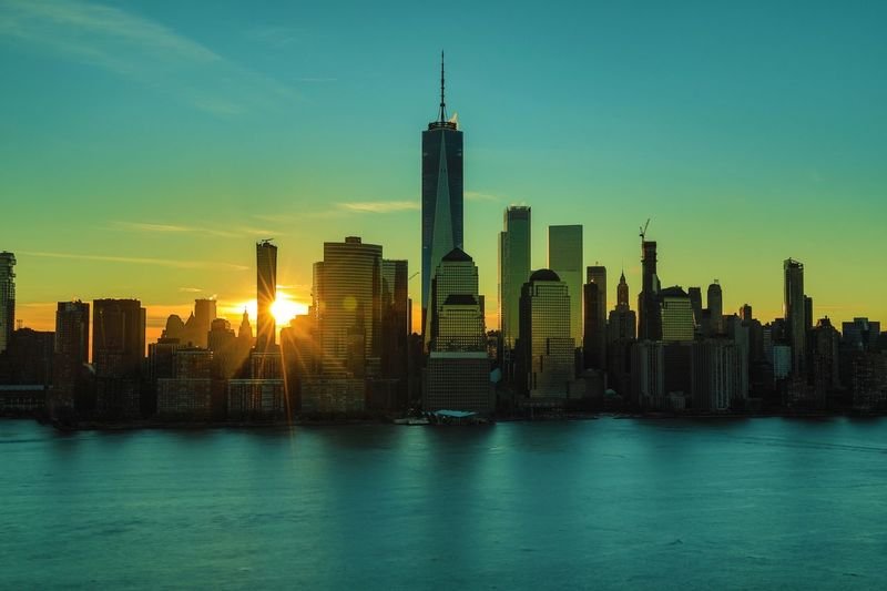 Sunrise Morning Light Morning World Trade Center NYC Manhattan Downtown Battery Park Hudson River New York New York City Building Exterior Built Structure Architecture City Skyscraper Building Office Building Exterior Sky Landscape Water Urban Skyline Cityscape Tall - High Waterfront Travel Destinations Office Tower Nature No People