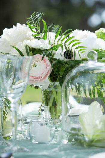 Close-up of flowers in water on table