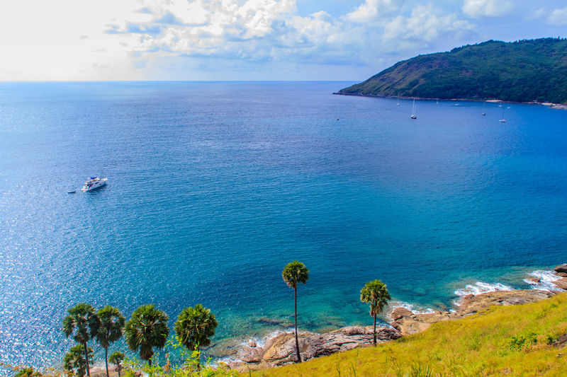 Beautiful seascape view of phuket cliff and small islands nearby Promthep cape, the most beautiful sunset viewpoint in Phuket, Thailand. Coastline Coastline Landscape Coastline Landscape Blue Beach Sea Outdoors Sky Scenics Real People Nature Day Water Coastline Nature Water Grass Sea Sky PromThepCape Promthep Cape Aerial View Beach Beauty In Nature Blue Cliff View Cliffs And Water Cliffside Coastline Beauty Coastline Sky Day Grass And Sky High Angle View Horizon Over Water Jet Boat Nature Nautical Vessel No People Outdoors Promthep Sand Scenics Sea Sky Small Island Small Islands Tranquil Scene Tranquility Tree Viewpoint Water