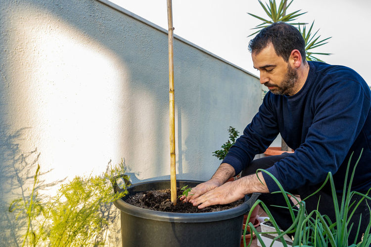 Man working in potted plant