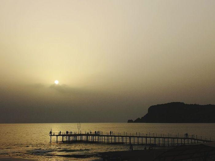 #silhouette #NoFilter #Antalya #alanya #mate10pro #sunshine #people #City #seaandsky #sunset #EyeEm Water Bird Flamingo Sea Beach Sunset Sand Summer Silhouette Sun